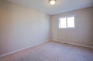 Photo 18: 350 Bridleridge Way SW in Calgary: Bridlewood Detached for sale : MLS®# A1039125