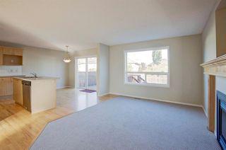 Photo 4: 350 Bridleridge Way SW in Calgary: Bridlewood Detached for sale : MLS®# A1039125