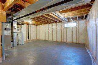 Photo 26: 350 Bridleridge Way SW in Calgary: Bridlewood Detached for sale : MLS®# A1039125