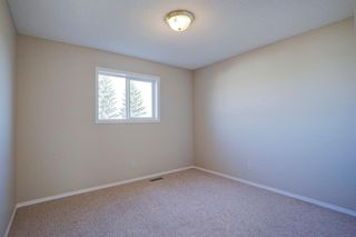 Photo 21: 350 Bridleridge Way SW in Calgary: Bridlewood Detached for sale : MLS®# A1039125