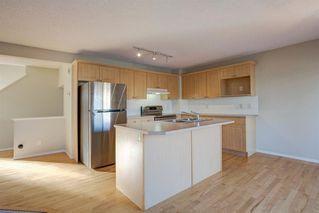 Photo 6: 350 Bridleridge Way SW in Calgary: Bridlewood Detached for sale : MLS®# A1039125