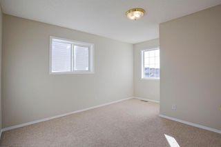 Photo 23: 350 Bridleridge Way SW in Calgary: Bridlewood Detached for sale : MLS®# A1039125