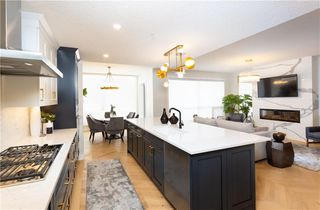 Photo 5: 310 15 Cougar Ridge Landing SW in Calgary: Cougar Ridge Apartment for sale : MLS®# C4267120