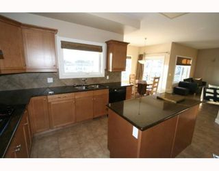 Photo 3: 102 ARBOUR VISTA Close NW in CALGARY: Arbour Lake Residential Detached Single Family for sale (Calgary)  : MLS®# C3379443