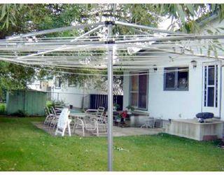 Photo 4: 209 WHARTON Boulevard in WINNIPEG: Westwood / Crestview Residential for sale (West Winnipeg)  : MLS®# 2816273