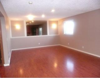 Photo 10: 258 MAPLE GROVE Crescent: Strathmore Residential Detached Single Family for sale : MLS®# C3414444