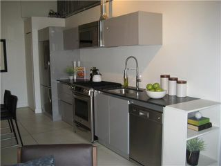 """Photo 2: 319 1529 W 6TH Avenue in Vancouver: False Creek Condo for sale in """"SOUTH GRANVILLE LOFTS"""" (Vancouver West)  : MLS®# V851772"""