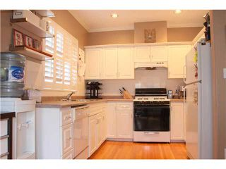 Photo 5: 1927 CHARLES Street in Vancouver: Grandview VE House 1/2 Duplex for sale (Vancouver East)  : MLS®# V859734