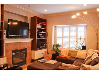 Photo 3: 1927 CHARLES Street in Vancouver: Grandview VE House 1/2 Duplex for sale (Vancouver East)  : MLS®# V859734