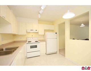 """Photo 2: 411 5759 GLOVER Road in Langley: Langley City Condo for sale in """"COLLEGE COURT"""" : MLS®# F2920211"""