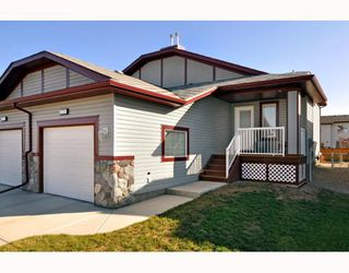 Photo 2: 579 STONEGATE Way NW: Airdrie Residential Attached for sale : MLS®# C3397152