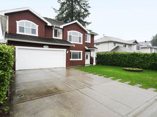 Photo 1: 2466 FRISKIE Avenue in Port Coquitlam: Woodland Acres PQ House for sale : MLS®# R2435749