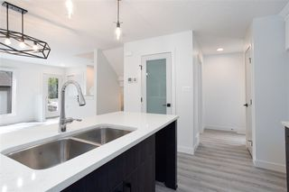 Photo 7: 11252 93 Street in Edmonton: Zone 05 Duplex Front and Back for sale : MLS®# E4208944
