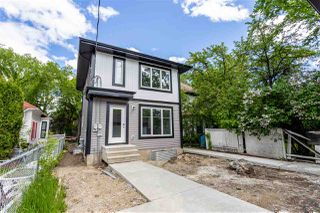 Photo 2: 11252 93 Street in Edmonton: Zone 05 Duplex Front and Back for sale : MLS®# E4208944