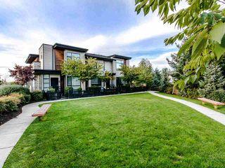 "Main Photo: 32 15688 28 Avenue in Surrey: Grandview Surrey Townhouse for sale in ""SAKURA"" (South Surrey White Rock)  : MLS®# R2511711"