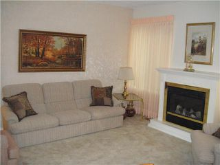 Photo 2: 4687 GARDEN GROVE Drive in Burnaby: Greentree Village Townhouse for sale (Burnaby South)  : MLS®# V826622