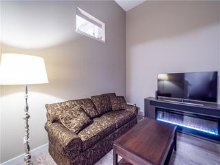 Photo 4: 201 SILVERADO PLAINS Park SW in Calgary: Silverado Row/Townhouse for sale : MLS®# C4299654