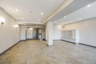Photo 3: 409 19940 BRYDON Crescent in Langley: Langley City Condo for sale : MLS®# R2514776