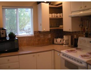 """Photo 2: 7492 HAWTHORNE Terrace in Burnaby: Highgate Townhouse for sale in """"Rockhill"""" (Burnaby South)  : MLS®# V767088"""