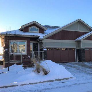 Photo 1: 15 8132 217 Street in Edmonton: Zone 58 House Half Duplex for sale : MLS®# E4173675