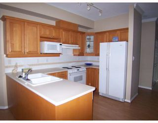 """Photo 7: 243 3098 GUILDFORD Way in Coquitlam: North Coquitlam Condo for sale in """"MARLBOROUGH HOUSE"""" : MLS®# V754550"""