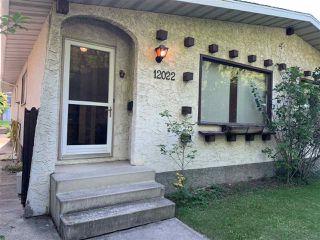 Photo 2: 12022-12024 79 Street in Edmonton: Zone 05 House Duplex for sale : MLS®# E4171150