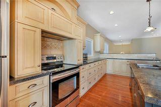 Photo 10: 817 Beckner Crescent: Carstairs Detached for sale : MLS®# C4300369