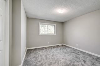 Photo 10: 97 FALSHIRE Terrace NE in Calgary: Falconridge Row/Townhouse for sale : MLS®# A1046001