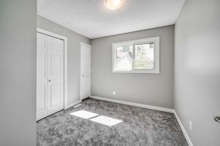 Photo 7: 97 FALSHIRE Terrace NE in Calgary: Falconridge Row/Townhouse for sale : MLS®# A1046001