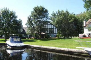 Photo 1: 2 51 Laguna Parkway in Lagoon City: Condo for sale (X17: ANTEN MILLS)  : MLS®# X1567398