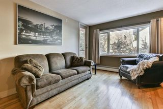 Photo 2: 205 716 3 Avenue NW in Calgary: Sunnyside Apartment for sale : MLS®# A1032794