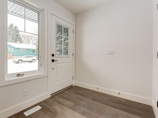 Photo 2: 2822 1 Street NW in Calgary: Tuxedo Park Row/Townhouse for sale : MLS®# A1050619