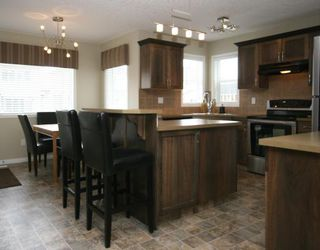 Photo 2: 442 LUXSTONE Green SW in : Airdrie Residential Detached Single Family for sale : MLS®# C3413894