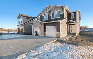 Photo 1: 1 Willows Court: Cochrane Semi Detached for sale : MLS®# A1055547