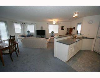Photo 8: 2111 928 ARBOUR LAKE Road NW in CALGARY: Arbour Lake Condo for sale (Calgary)  : MLS®# C3402855