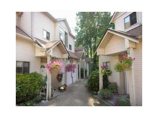"""Photo 1: 47 98 BEGIN Street in Coquitlam: Maillardville Townhouse for sale in """"LE PARC"""" : MLS®# V855358"""