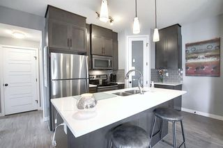 Photo 12: 1911 2461 Baysprings Link SW: Airdrie Row/Townhouse for sale : MLS®# A1030065
