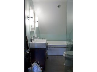 """Photo 7: 404 W 23RD Avenue in Vancouver: Cambie House for sale in """"CAMBIE VILLAGE"""" (Vancouver West)  : MLS®# V828426"""