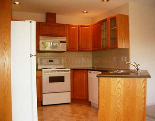 "Photo 4: 255 20391 96TH AV in Langley: Walnut Grove Townhouse for sale in ""CHELSEA GREEN"" : MLS®# F2615492"