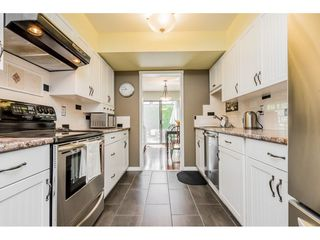 """Photo 10: 127 13880 74 Avenue in Surrey: East Newton Townhouse for sale in """"WEDGEWOOD ESTATES"""" : MLS®# R2469175"""