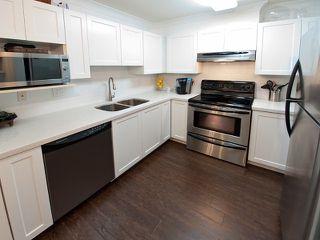 Photo 4: 103 6385 121ST Street in Surrey: Panorama Ridge Condo for sale : MLS®# F1303927