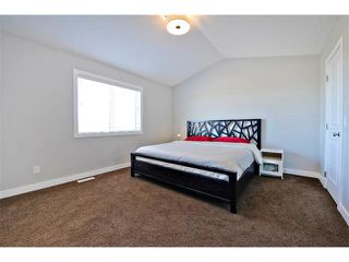 Photo 18: 140 FIRESIDE Place: Cochrane House for sale : MLS®# C4013130