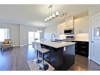 Photo 4: 140 FIRESIDE Place: Cochrane House for sale : MLS®# C4013130