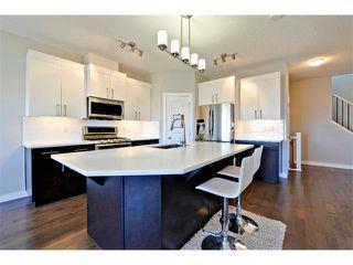 Photo 5: 140 FIRESIDE Place: Cochrane House for sale : MLS®# C4013130