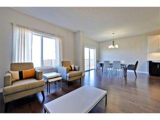 Photo 10: 140 FIRESIDE Place: Cochrane House for sale : MLS®# C4013130