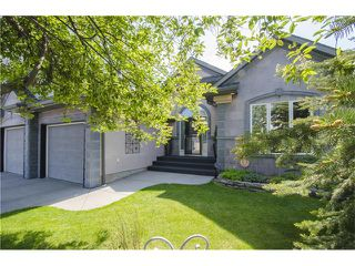Photo 1: 55 STRATHRIDGE Gardens SW in Calgary: Strathcona Park House for sale : MLS®# C4063885