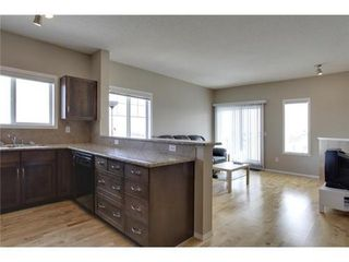 Photo 2: 2401 43 COUNTRY VILLAGE Lane NE in Calgary: Single Level Apartment for sale : MLS®# C3517369