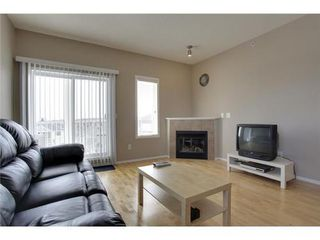 Photo 4: 2401 43 COUNTRY VILLAGE Lane NE in Calgary: Single Level Apartment for sale : MLS®# C3517369