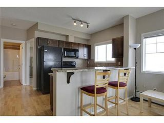 Photo 3: 2401 43 COUNTRY VILLAGE Lane NE in Calgary: Single Level Apartment for sale : MLS®# C3517369