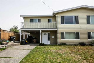 Photo 1: 7590 DAVIES Street in Burnaby: Edmonds BE House 1/2 Duplex for sale (Burnaby East)  : MLS®# R2107790